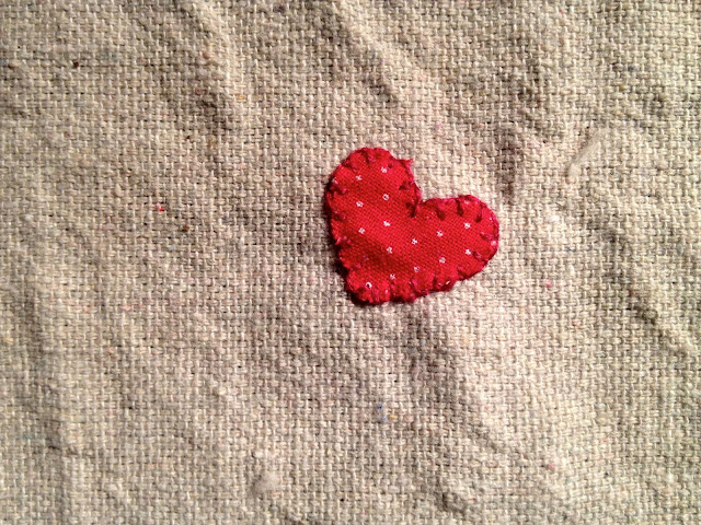 appliqued heart using buttonhole stitch