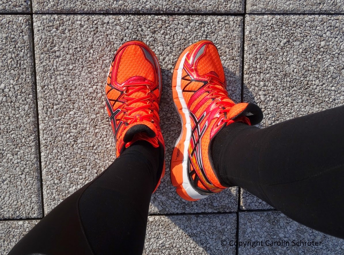 Bright orange sport shoes by Asics