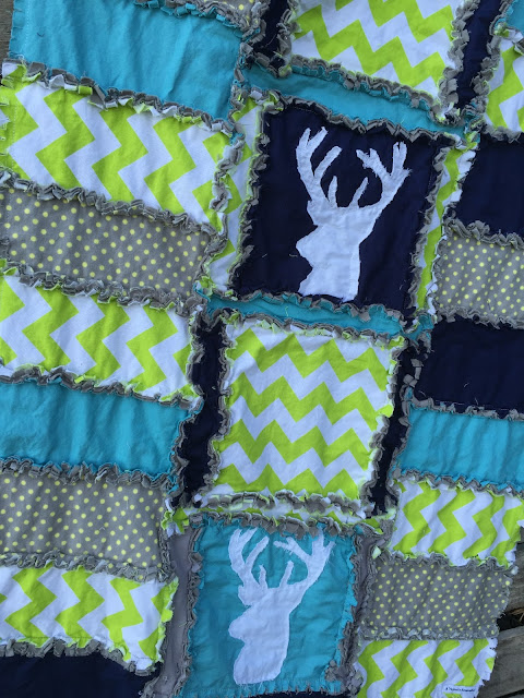 Closeup of Stag Raw Edge Appliqued Deer Head Silhouette on the Rag Quit Baby Blanket by A Vision to Remember