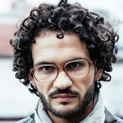 Latest Hairstyle Curly Hair on Men 5 Medium Cuts