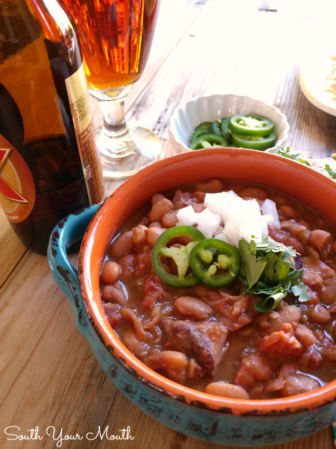 Mexican Borracho Beans cooked low and slow with pinto beans, pork, spices and beer. THE PERFECT side dish to your next Mexican feast!