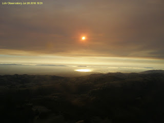 Setting sun obscured by smoke from Soberanes wildfire, view from west-facing camera atop Lick Observatory, Mt. Hamilton, California