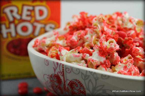 RED HOT Cinnamon Popcorn - all you need is a little water and red hots! Perfect snack, with a kick! @whatchamakinnow