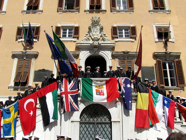 Town Hall staircase festooned with flags, Foreign Navies ceremony, Livorno