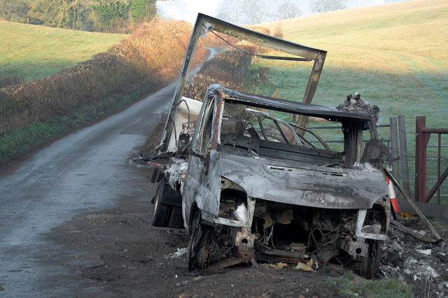 burnt out van in the country