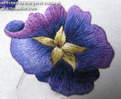 Detail of purple thread painted pansy with problems resolved. (Pansies designed by Trish Burr)