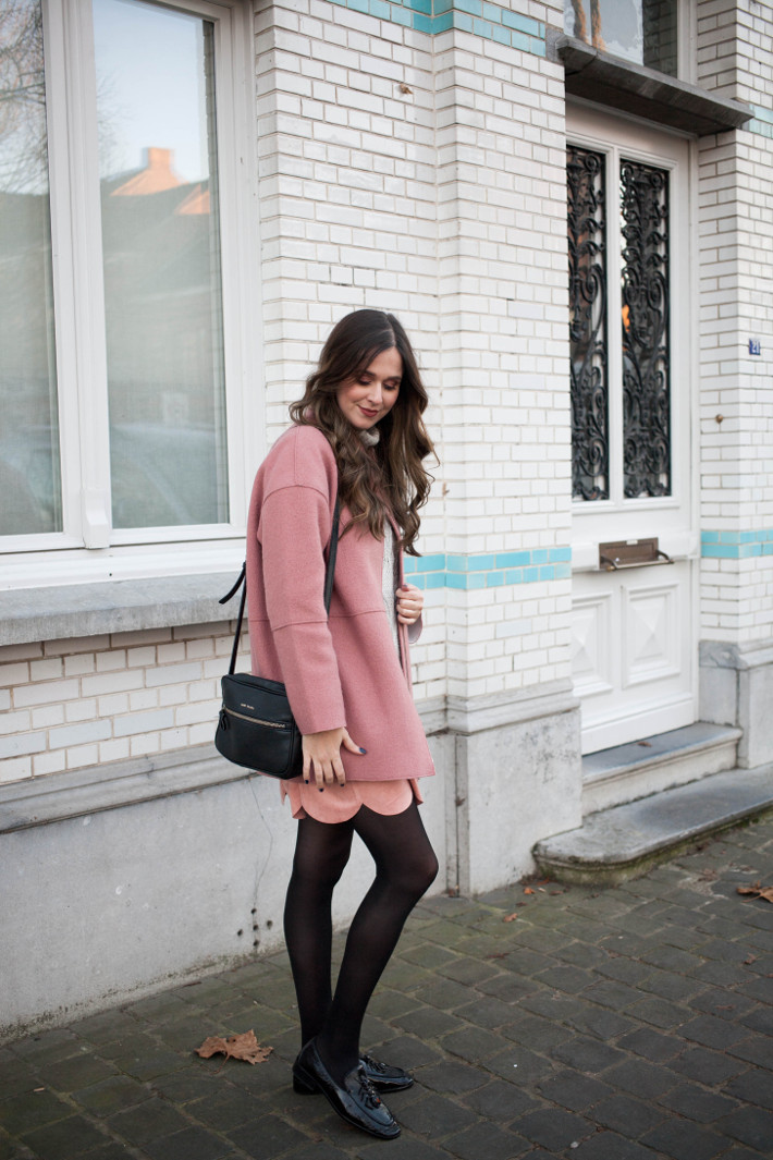 Outfit: pink coat, scallop hem skirt, patent loafers