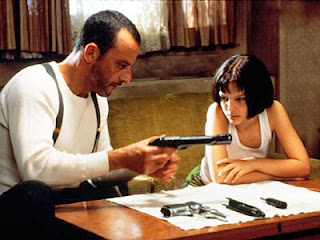 Jean Reno as Léon, and Natalie Portman as Mathilda in Léon: The Professional, Directed by Luc Besson