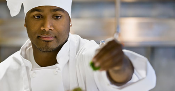 Black chef using seasoning