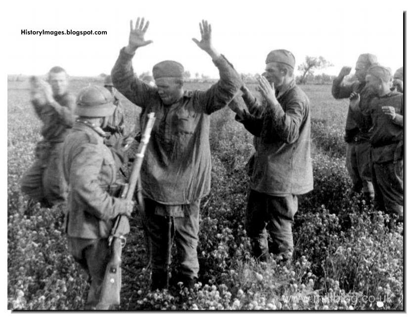 Searching captured Red Army soldiers for hidden weapons