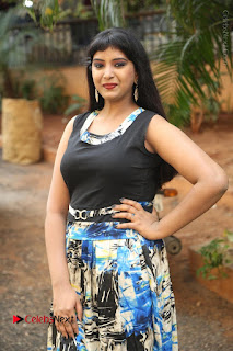 Actress Model Poorni Stills in Floral Long Dress at Silk India Expo Launch  0018.JPG