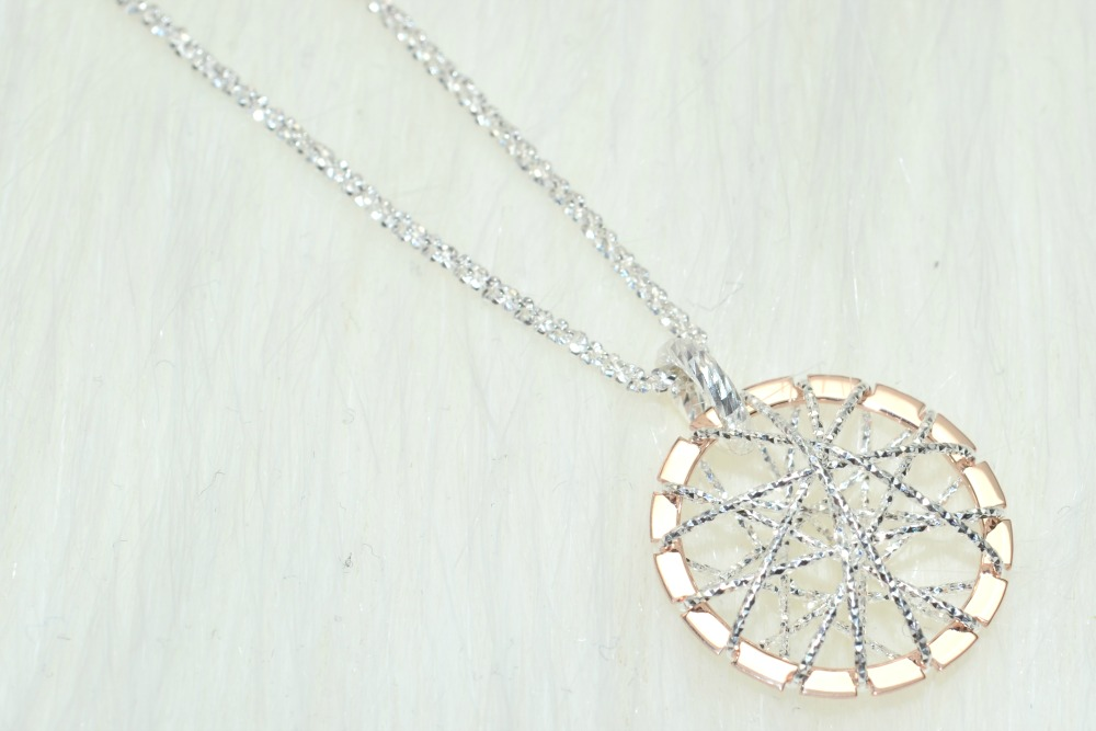 Up close image of the intricate pendant