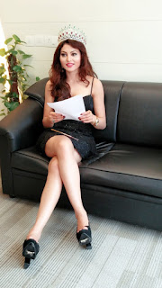 Urvashi Rautela Legs Show On Black Couch