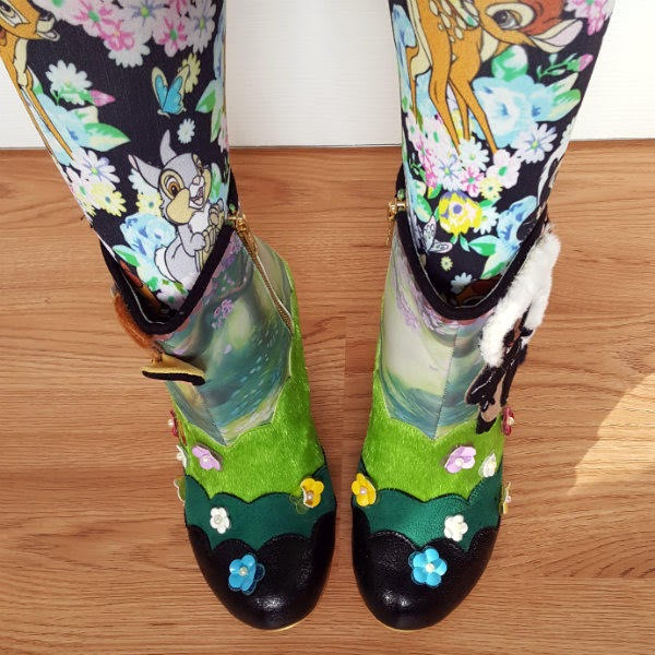 legs wearing disney bambi patterned tights with matching ankle boots with flower embellishments