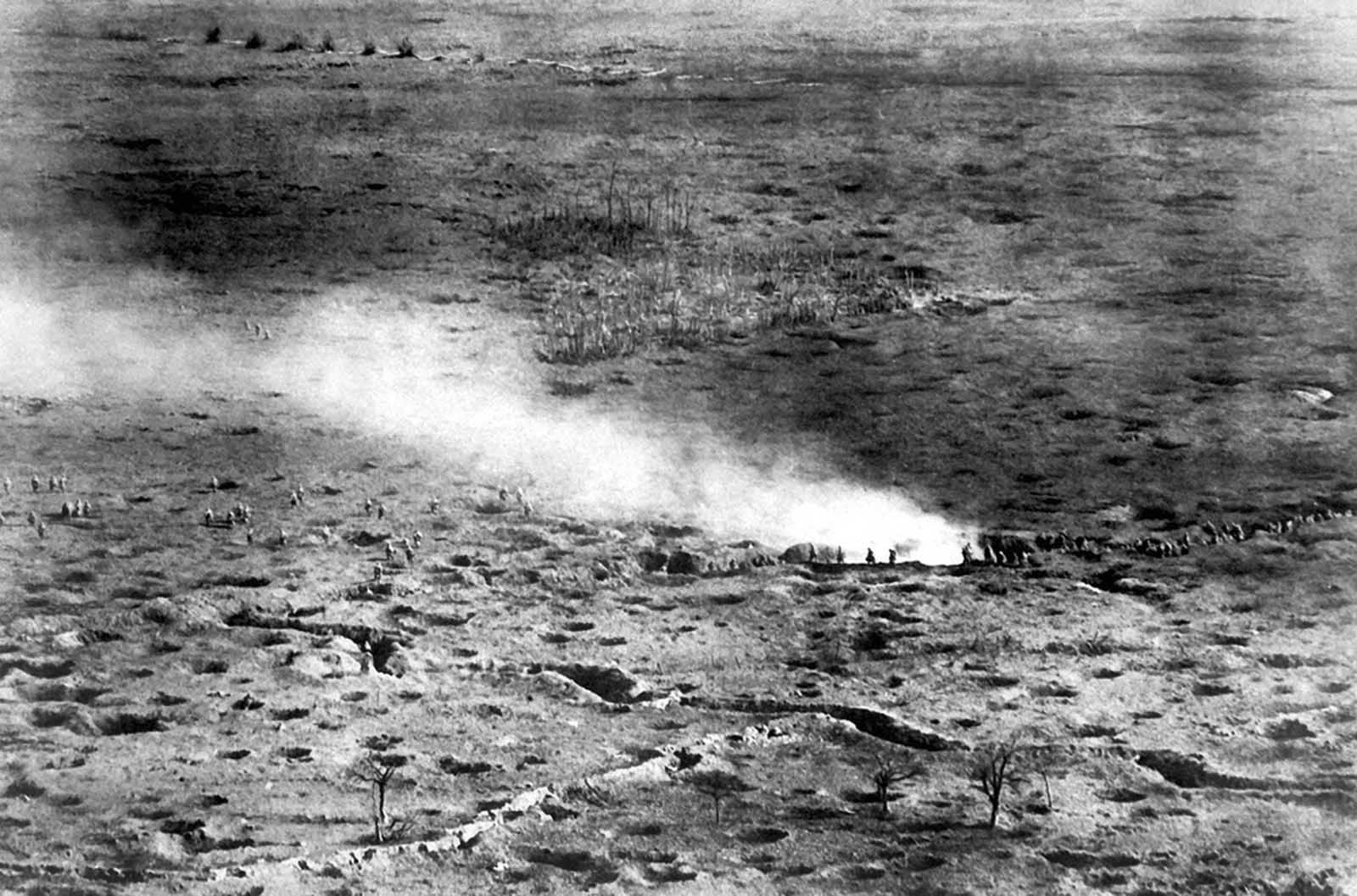 At a height of 150 meters above the fighting line, a French photographer was able to capture a photograph of French troops on the Somme Front, launching an attack on the Germans, ca. 1916. The smoke may have been deployed intentionally, as a screening device to mask the advance.