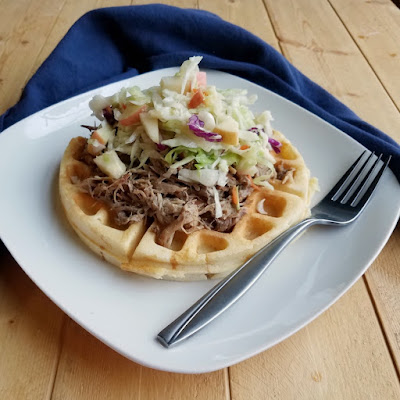 cider pulled pork on waffle with apple slaw