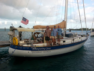 Mike, Nan, John and Brian aboard Whispering Jesse at Blue Water Marina