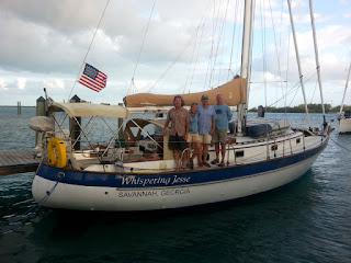 Mike, Nan, John and Brian aboard Whispering Jesse at Blue Water Marina