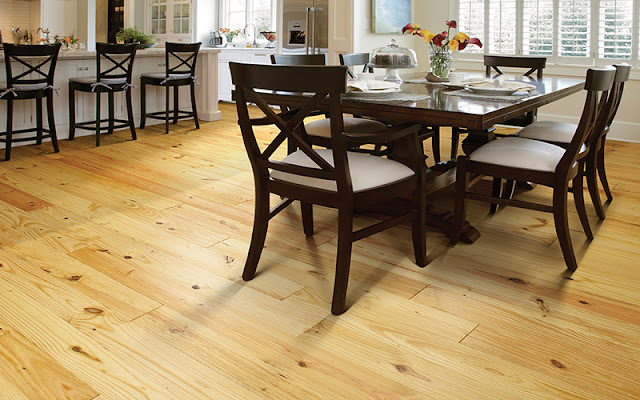 Beautiful natural hardwood floor stands up to the test in this kitchen/dining area.