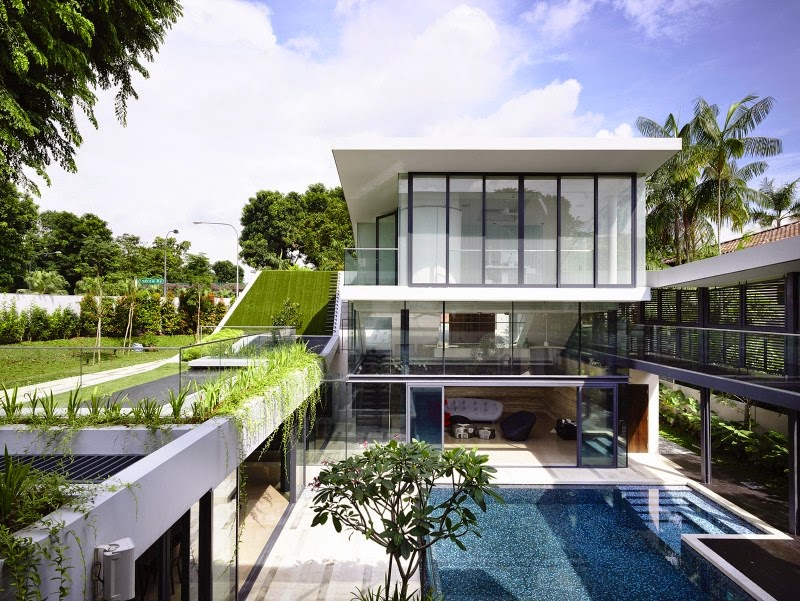 Singapore Contemporary House with Futuristic Sloping Green Roof and Pool on a storey below the street level