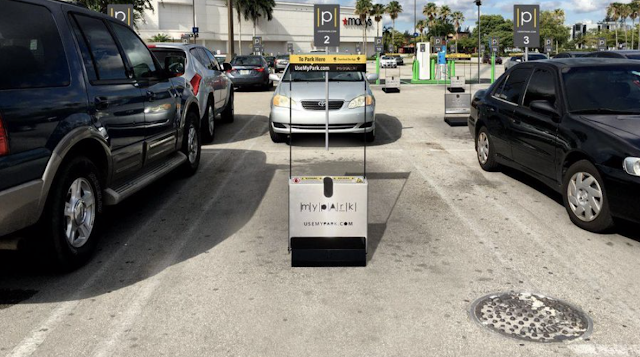 This Startup's Robots Hold Your Favorite Parking Space At The Mall -- Even On Black Friday