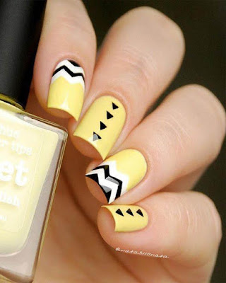 diseño de uñas amarillas figuras geométricas