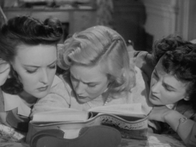 3 girls engrossed in Josephine Evans' latest novel.
