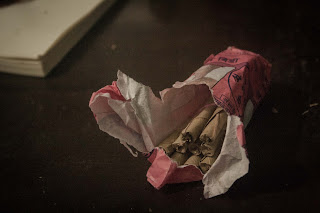 Bidi, a small hand-rolled cigarette made of tobacco, wrapped in a tendu or temburni leaf and tied on one or both ends with a colorful string.