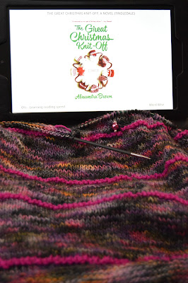 knitting a striped cowl with Pittura yarn and reading a holiday romance novel