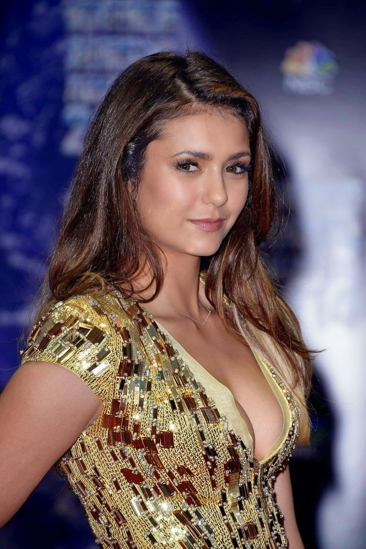 Nina Dobrev Flaunts Cleavage At The 2014 World Music