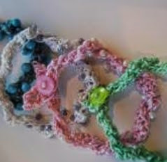 http://www.craftsy.com/pattern/crocheting/accessory/free-beaded-bracelet-with-a-twist/34025