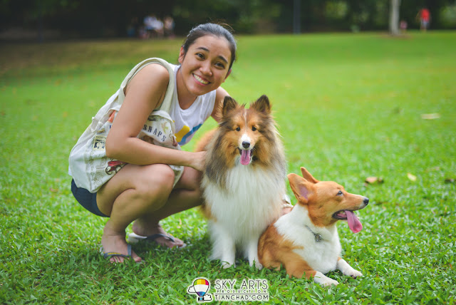 A happy girl when she saw cute dogs over there in Singapore Botanic Garden