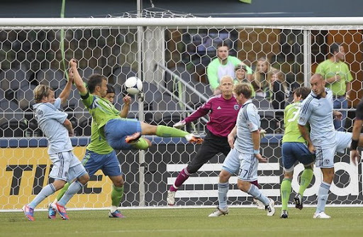 Seattle Sounders player Patrick Ianni scores against Sporting Kansas City with a scissor kick