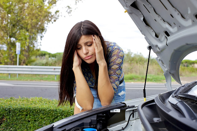 a woman desperate with engine failure