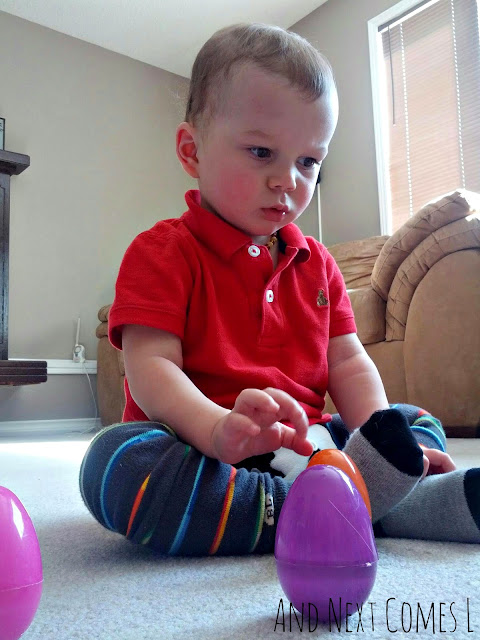K checking out the wobbly Easter eggs from And Next Comes L