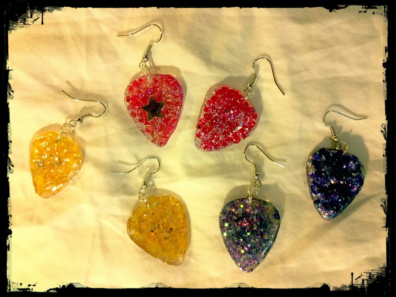 Light Catching guitar pick earrings