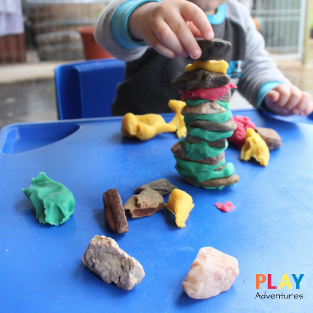 Building towers with rocks and playdough