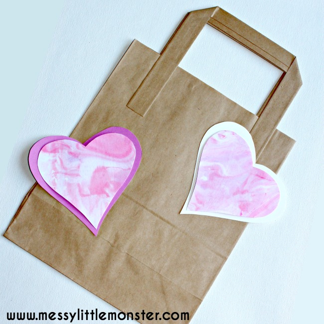 Easy kids marbled heart craft using shaving foam. A fun art and sensory heart activity for toddlers and preschoolers. Inspired by the story 'The day it Rained Hearts' and national reading month.