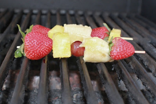 This is grilled fruit kabob for a barbecue in the backyard. The fruits are pineapple, cherry, strawberry with a coconut rum sauce. This is an easy dessert for the grill and great idea for a quick and easy dessert for any backyard family picnic food