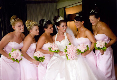 Large party of bridesmaids with high, sleek hair up