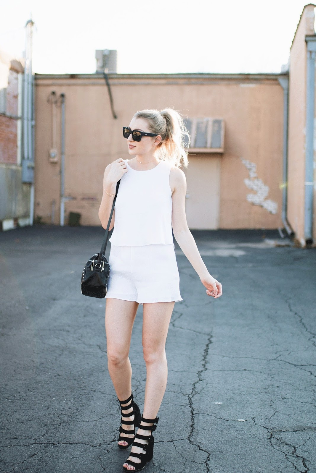 white romper with black heeled sandals