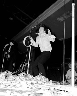 Stevie Wright (top) whamming his tambourine during an Easybeats performance in 1967.