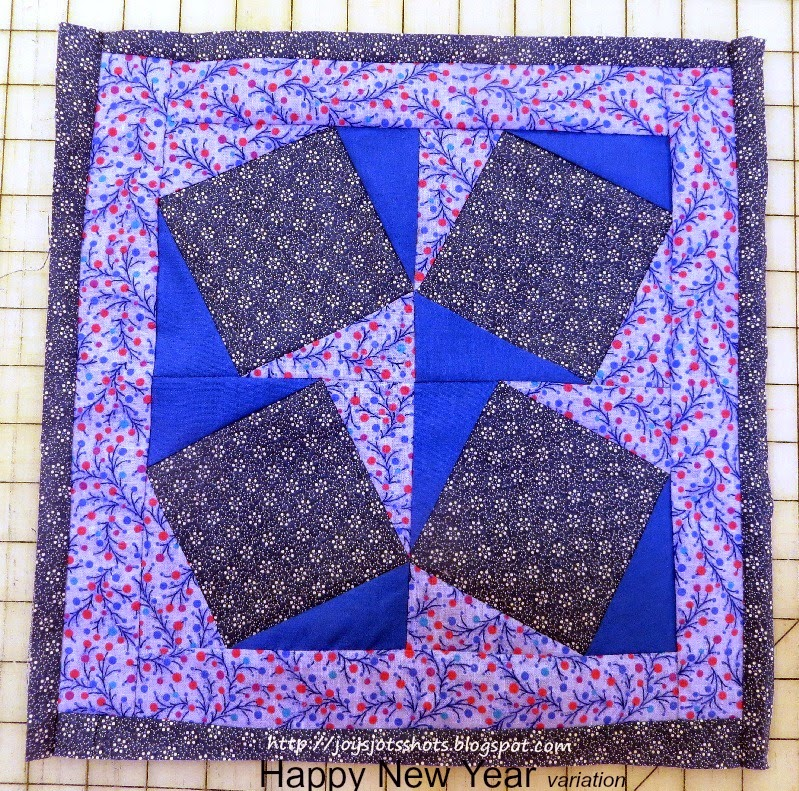 http://joysjotsshots.blogspot.com/2015/01/quilt-shot-block-27-happy-new-year.html