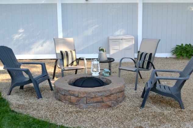 Plastic chairs around a fire pit