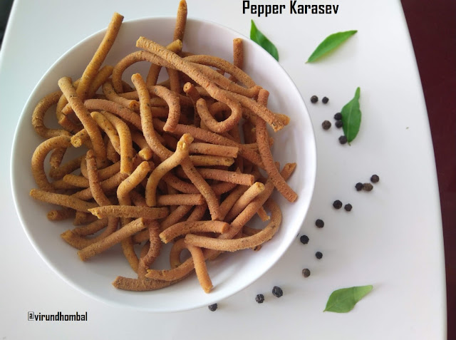 Pepper Karasev| Milagu Karasev - Pepper Karasev - prepared with besan flour,  rice flour and spiced up with chilly powder and freshly ground black pepper powder. Great evening snack during winter days. If you are looking for an easy snack to prepare within an hour, try this pepper karasev. It comes together easily without much work. Karasev is typically made by scrapping the dough in a ladoo ladle. It's difficult for me to scrape directly into the hot oil, so I prefer to use the murukku press. But if you like the traditional method, you can prepare as you wish. or the flour, try to use freshly prepared homemade besan flour and rice flour. If you don't have much time, use good quality besan flour and rice flour. Please do not use store bought black pepper powder for this karasev, because your karasev won't taste good. In store bought black pepper powder they will powder, it finely and you cannot enjoy the taste of the black peppers in the sev. Moreover the sev tastes flavourful in the homemade coarsely powdered black pepper.