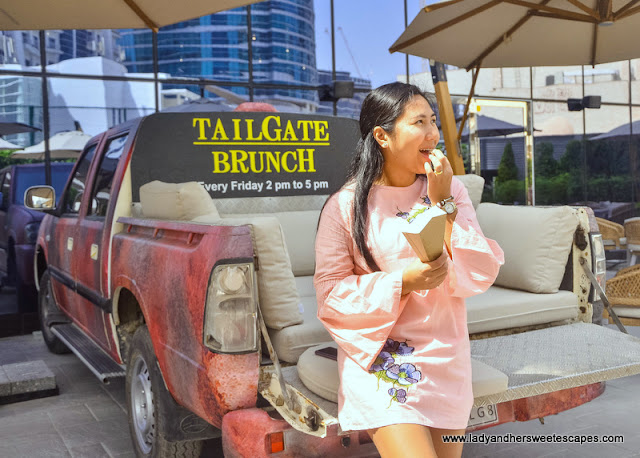 lady in tailgate brunch dubai