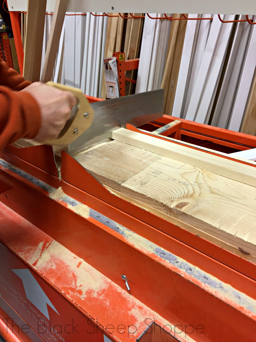 Sawing trim pieces at Home Depot