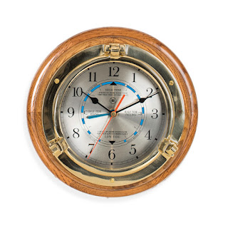 https://bellclocks.com/products/brass-porthole-time-tide-clock-on-oak-wood-bey-berk-sq528