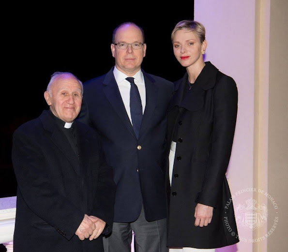 Prince Albert and Princess Charlene of Monaco appear on the balcony of the prince's palace to celebrate Good Friday