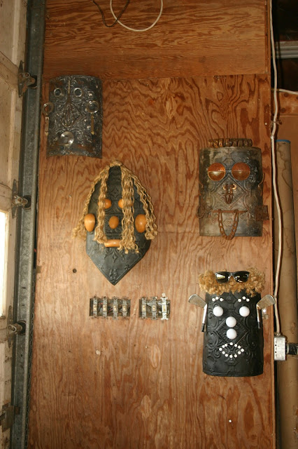 Found object art: face masks by Fred Leach